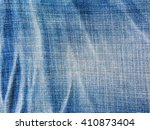close up blue jeans background... | Shutterstock . vector #410873404
