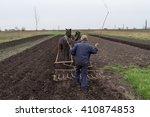 A Farmer Cultivates The Land...