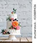 white wedding cake with flowers ... | Shutterstock . vector #410889436