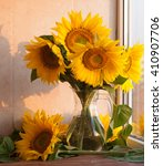 Sunflowers In A Glass Vase On ...
