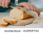 male hands cutting wheaten... | Shutterstock . vector #410909743