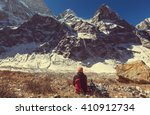 hiker in himalayas mountain.... | Shutterstock . vector #410912734