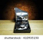 opened and broken the hard... | Shutterstock . vector #410935150