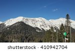Snowy mountains and pine forests of the Caucasus - stock photo