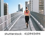 young female running in a city... | Shutterstock . vector #410945494