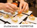 cook put red caviar on prepared ... | Shutterstock . vector #410989768