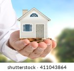 holding house representing home ... | Shutterstock . vector #411043864