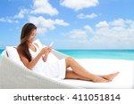 woman using phone app relaxing... | Shutterstock . vector #411051814