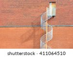 Spiraling Metal Stairs Up A Re...