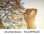 woman with hat relaxing... | Shutterstock . vector #411099610