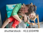 portrait of  young mother with... | Shutterstock . vector #411103498