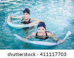 smiling women in the pool with... | Shutterstock . vector #411117703