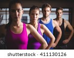 fit people with hands on hips... | Shutterstock . vector #411130126
