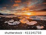 sunrise at jokulsarlon glacier... | Shutterstock . vector #411141733