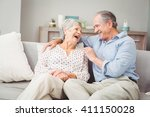 romantic senior couple laughing ... | Shutterstock . vector #411150028