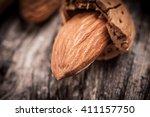 tasty almond nuts on rustic... | Shutterstock . vector #411157750
