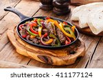 beef fajitas with colorful bell ... | Shutterstock . vector #411177124