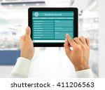 medical tablet in doctor hands... | Shutterstock . vector #411206563