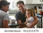 male gay dads use tablet with... | Shutterstock . vector #411211570
