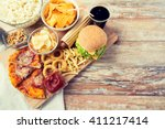 fast food and unhealthy eating... | Shutterstock . vector #411217414