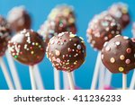 chocolate cake pops on a blue... | Shutterstock . vector #411236233