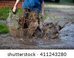 Little Boy Splashing In A Mud...