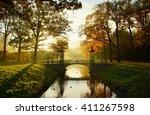 misty autumn morning in... | Shutterstock . vector #411267598