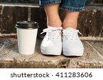 woman feet in white sneakers... | Shutterstock . vector #411283606