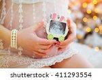 pregnant woman holds ultrasound ... | Shutterstock . vector #411293554