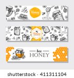 vector hand drawn honey banners.... | Shutterstock .eps vector #411311104
