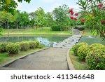 footpath in garden across canal    Shutterstock . vector #411346648