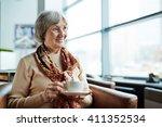 female with tea   Shutterstock . vector #411352534