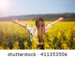 Young Woman In A Rapeseed Field....