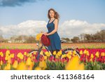beautiful woman standing with... | Shutterstock . vector #411368164