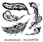 hand drawn feathers set on... | Shutterstock .eps vector #411369550