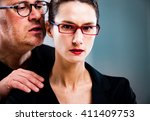 Small photo of business man maybe a manager molesting a woman on the job in their workplace