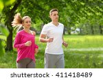 young man and woman running in... | Shutterstock . vector #411418489