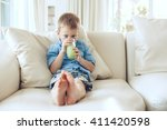 the boy drinking juice on the... | Shutterstock . vector #411420598