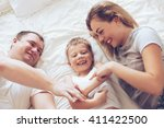 young parents with their 6... | Shutterstock . vector #411422500