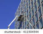 worker cleaning windows service ... | Shutterstock . vector #411504544
