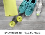 yoga mat with sport shoes and... | Shutterstock . vector #411507538