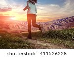 young lady running on a rural...   Shutterstock . vector #411526228