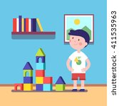 boy build a castle with wooden... | Shutterstock .eps vector #411535963
