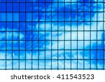 clouds reflected in windows of... | Shutterstock . vector #411543523