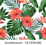 tropical flowers and leaves on... | Shutterstock .eps vector #411556180