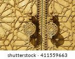door at royal palace in fes ... | Shutterstock . vector #411559663