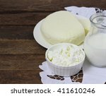 dairy products on wooden table. | Shutterstock . vector #411610246