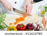 female cook preparing food in... | Shutterstock . vector #411613780