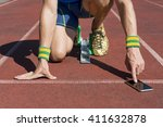 athlete crouching at the... | Shutterstock . vector #411632878