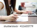 close up work woman writing on... | Shutterstock . vector #411635779